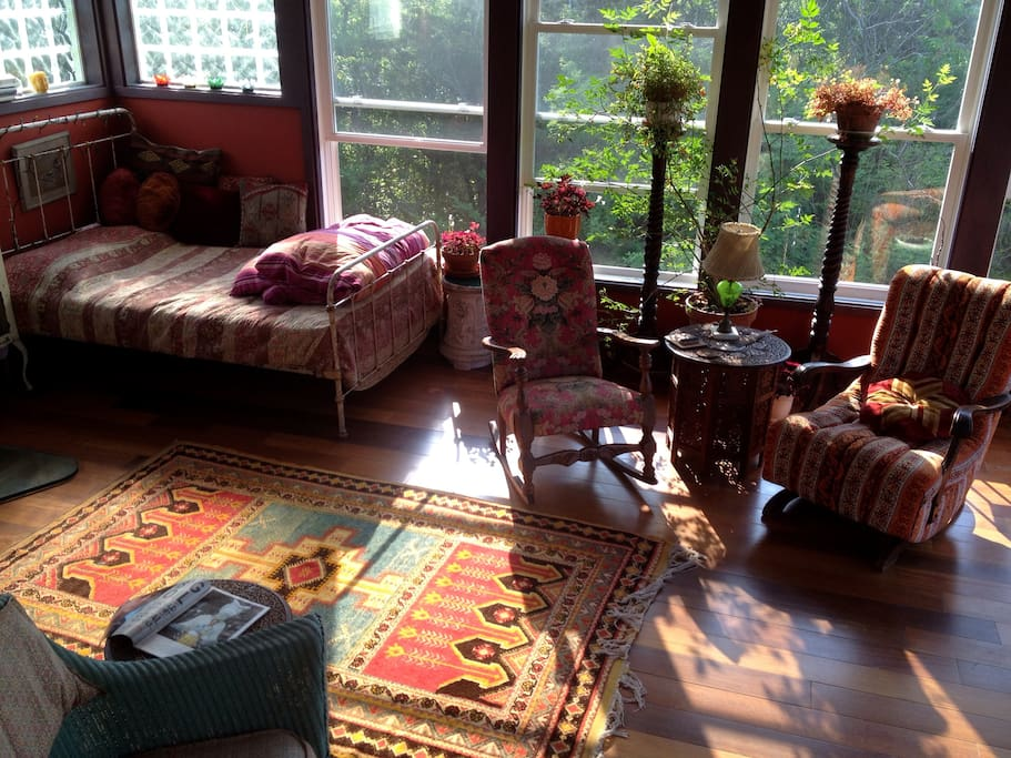 This sunroom (bedroom #5) is flooded with light and space and has separate entrance.