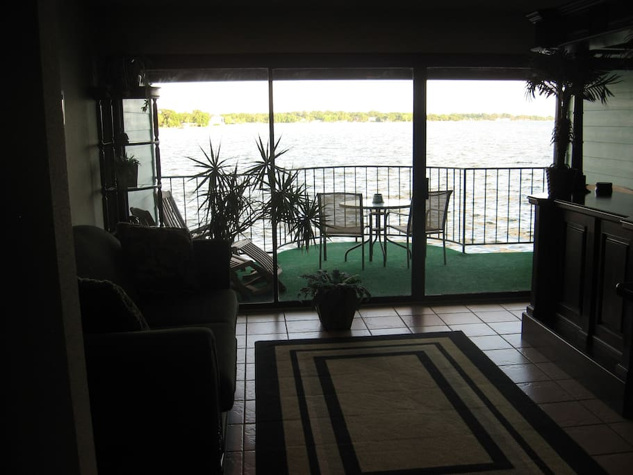 Floor to ceiling glass brings the lake right into your living room!