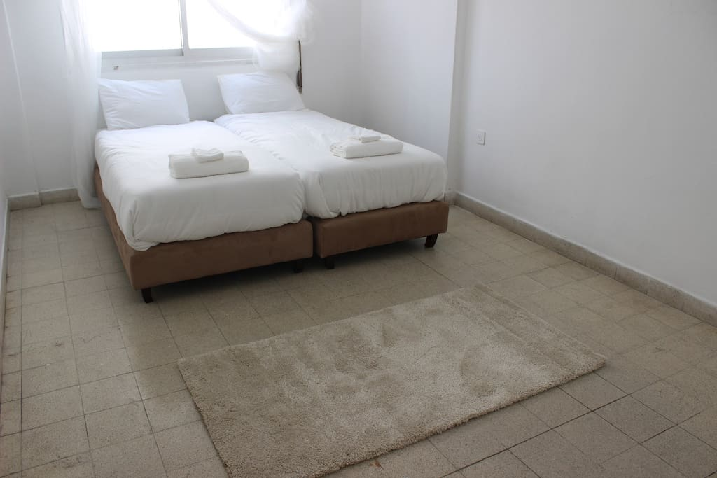 Bedroom with double bed . Can be separated