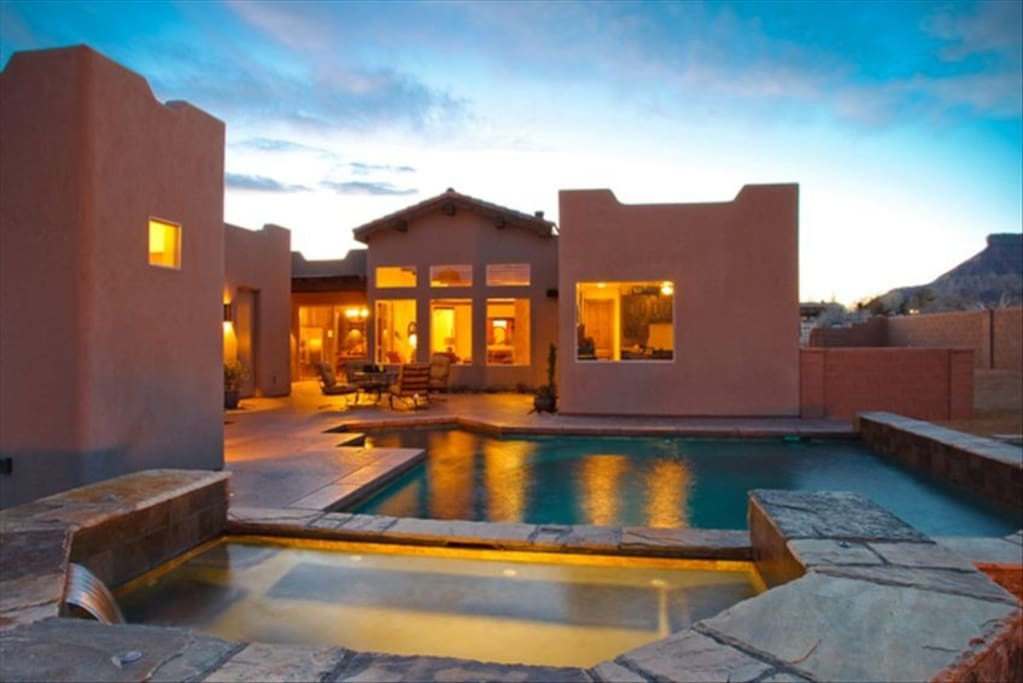 Exterior Rear View of House, Pool, and Hot Tub