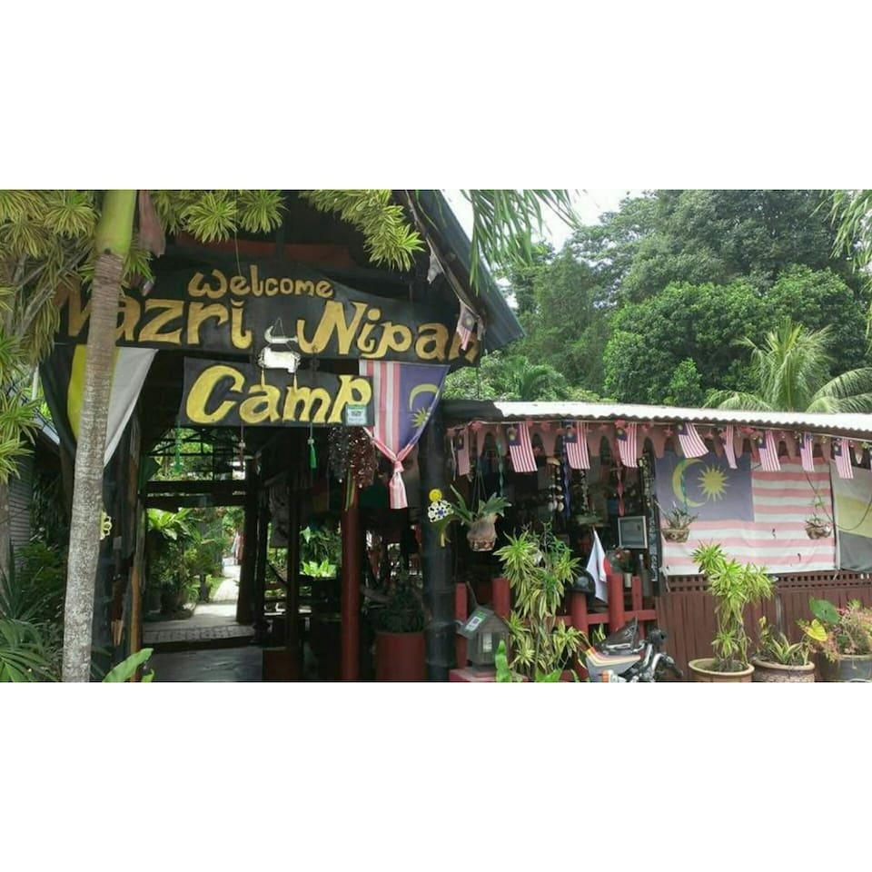 Cheapest Backpackers Stay Pangkor Island is owned by Nazri Nipah Campsite.Only 2mins walk to the beach. Variety of restaurants , food stalls and shops nearby also walking distance .Please keep in mind our accomodation is very very basic!