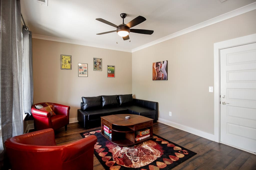 Gorgeous Hardwood Floors. Sofa with chaise converts to full size bed.