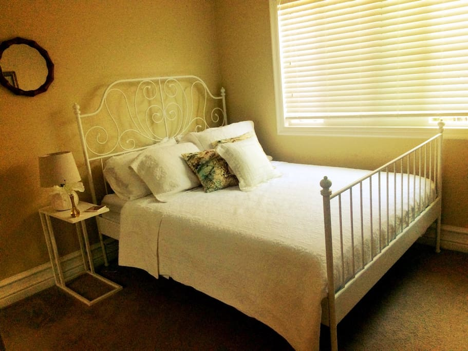 Guest bedroom. Nice light, large closet, queen bed, high quality sheets, towels and bedding