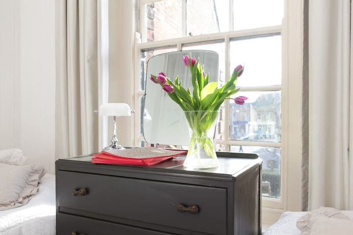 Twin bedroom. Hand-painted furniture and views or Georgian Holt across Shirehall Plain