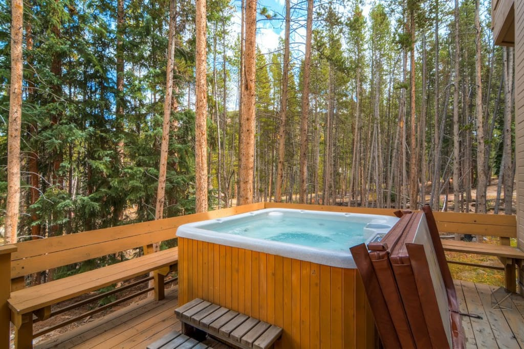 While the kids play inside, the adults can relax in the hot tub on the deck.