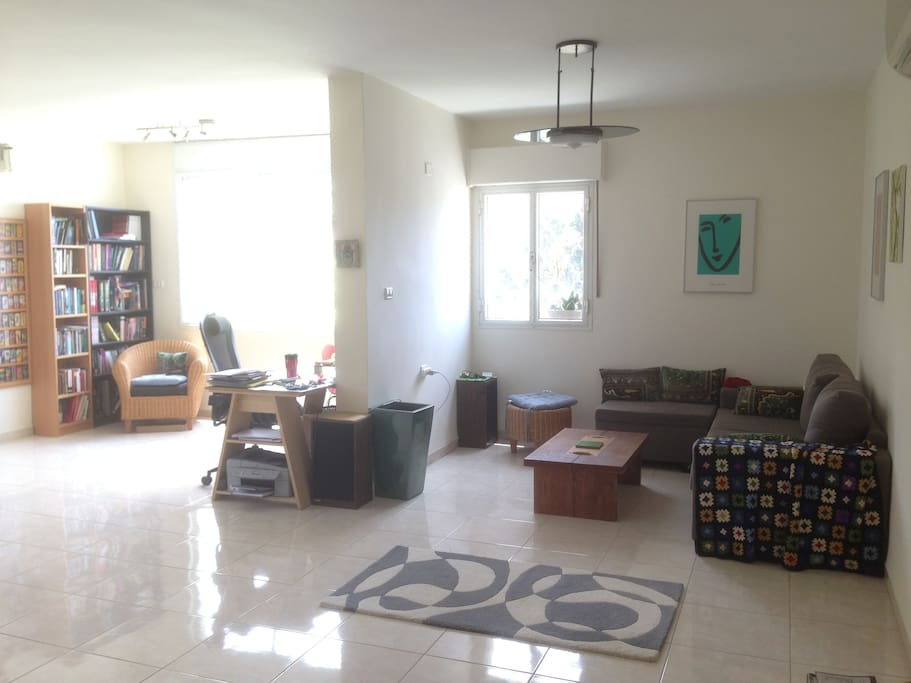 Huge living room and study area (free wifi) with plenty of natural light and green view from the windows