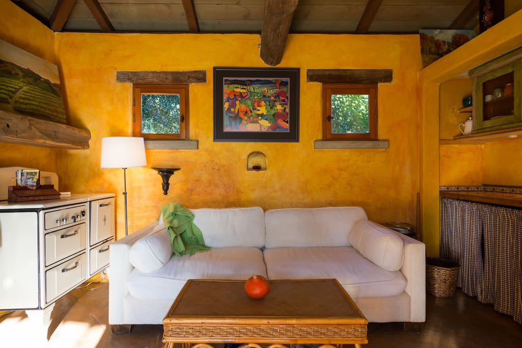 the casita sitting room has a gorgeous view of the garden with french doors to open wide