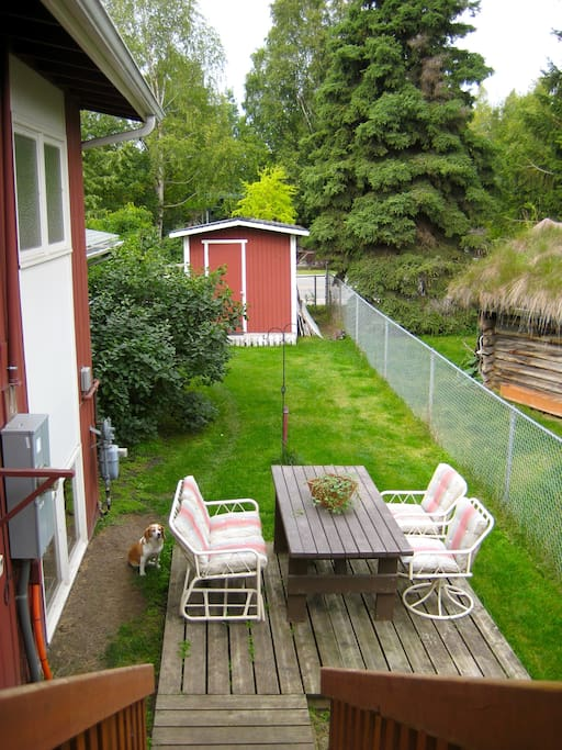 The backyard gets lovely sun all morning, and the area by the shed & fire pit gets gorgeous full sunlight on our long Alaskan summer nights.  We have several more chairs for lounging & relaxing - and much cuter covers for the chairs since this photo was t