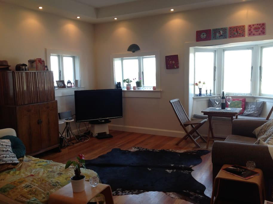 Our cosy and technology ready lounge room.  If you can stop looking out the window! Wooden floorboards throughout.
