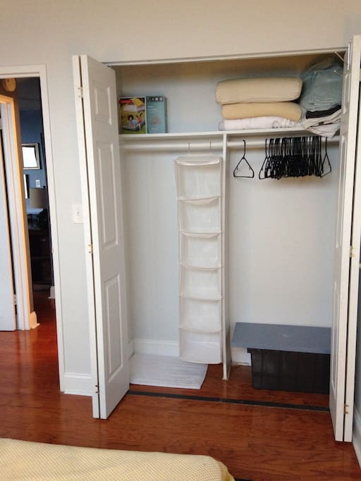 GUEST BEDROOM CLOSET WITH HANGERS AND HANGING SHELF FOR YOUR ITEMS