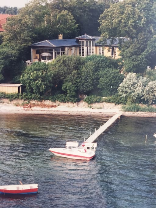 Private beach, pier and speed boat