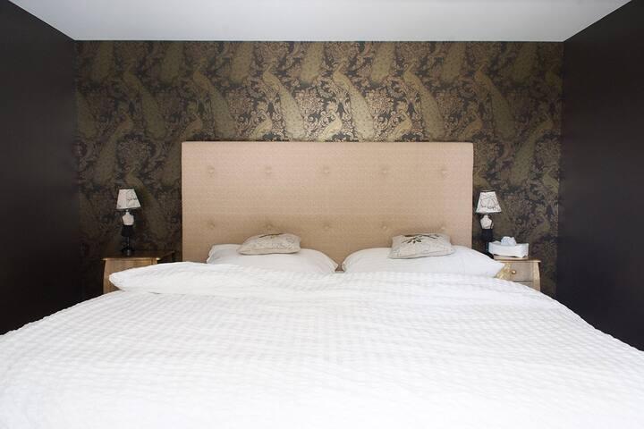 Sleeping room of the Suite