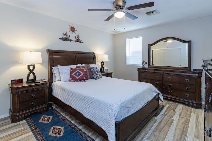 Adjustable queen bed with private bath with walk in shower