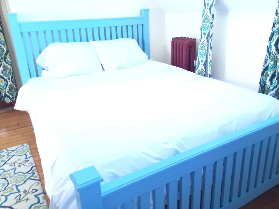 The sunny bedroom has a comfortable queen bed and a big walk-in closet.