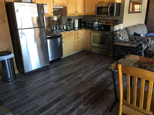 2017 update  The home now features a hardwood-like tile flooring through the kitchen and living room.  Please note that the rest of the pictures of the kitchen still show the old tile flooring that is no longer there.