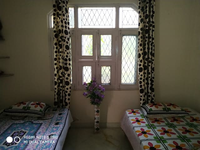 Second bedroom with smart tv, two single bed, DTH, Wi-Fi, study table, chair