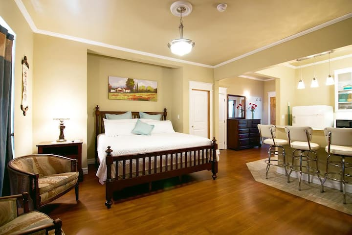 Nostalgic Studio Suite with Kitchen & Private Bath. Early 1950 theme decor marries modern and retro into a fun experience. Private Entry with adjoining door unlocked on request.