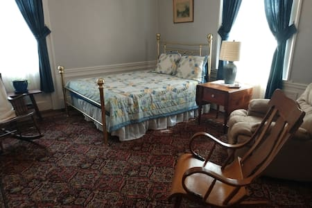 This is bedroom 3 of 5 our Oak room, it is the only room downstairs. This room contains a queen size bed and a wood fireplace. It is located across from the 1/2 bath downstairs. The cost is $90.00 per night. Includes breakfast with blueberry scones