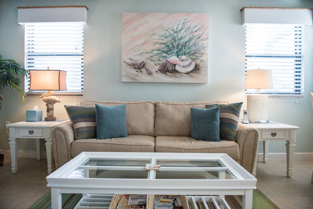 Lots of natural sunlight in this coastal inspired living area.