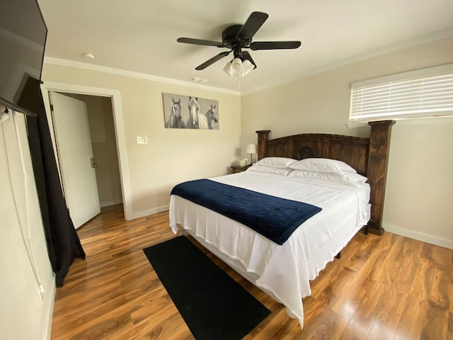 Upstairs bedroom suite. This is a king size bed. The room has a tv and balcony.