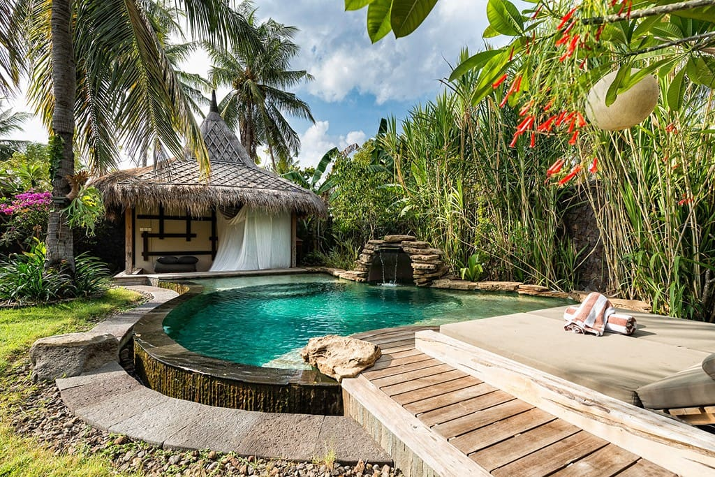 Chill out in a traditional Balinese bale (gazebo) near the pool with soothing waterfall