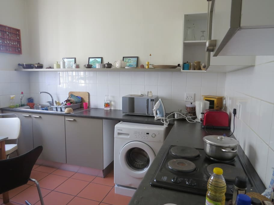 Kitchen with all appliances, including washing machine