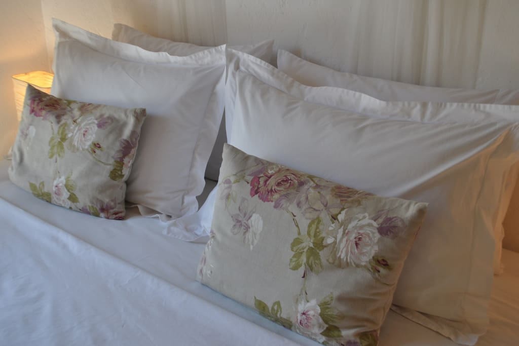 Comfortable king-size beds with fresh, white linen.