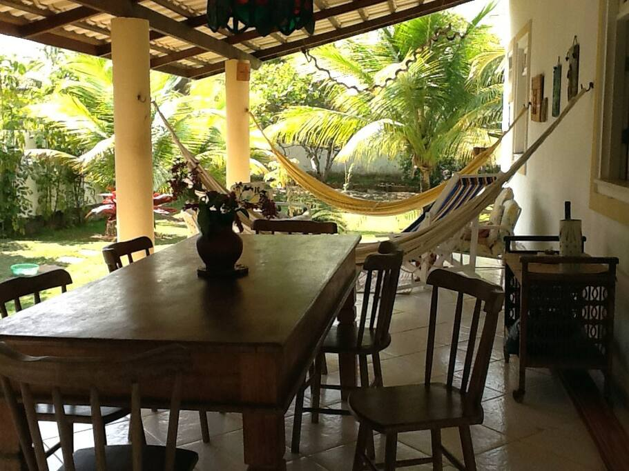 varanda with hammocks and dining