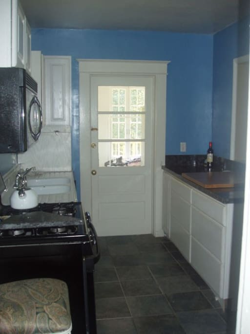 Kitchen with pass-thru to dining room and door leads to laundry room