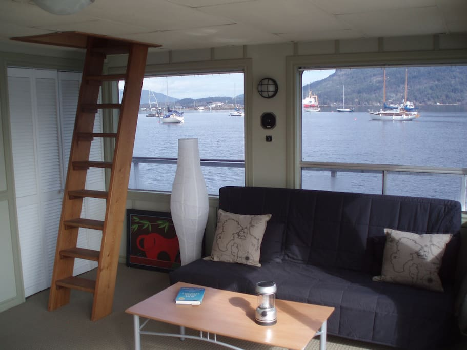The living room has large, tinted windows with awesome views of Cowichan Bay