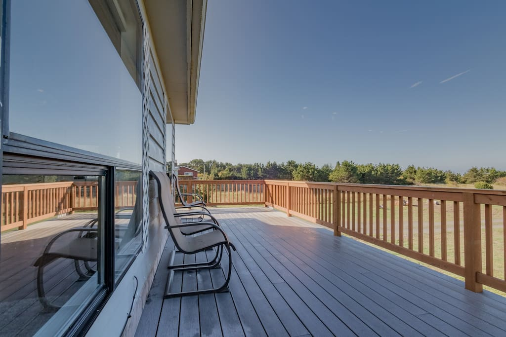 Large expansive deck. Picnic table, extra chairs and a barbecue have been added.