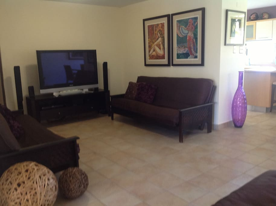 If you don't feel like enjoying the weather relax sit back and enjoy the beautiful living room with HD TV, Surround Sound System and A/C