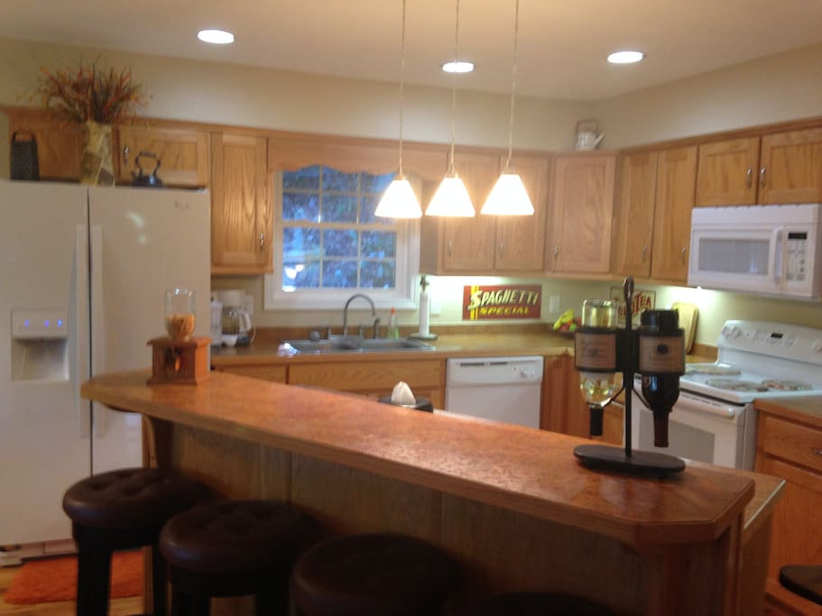 Kitchen includes Bar that sets 4....Microwave, double refrigerator,Freezer,Stove, Dishwasher.  All utensils including toaster oven, coffee maker, blender, baking utensils.  Just invite guests for wine and cheese and a night of fun.