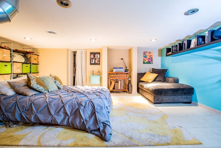 The studio includes a spacious queen bed for a very comfortable stay
