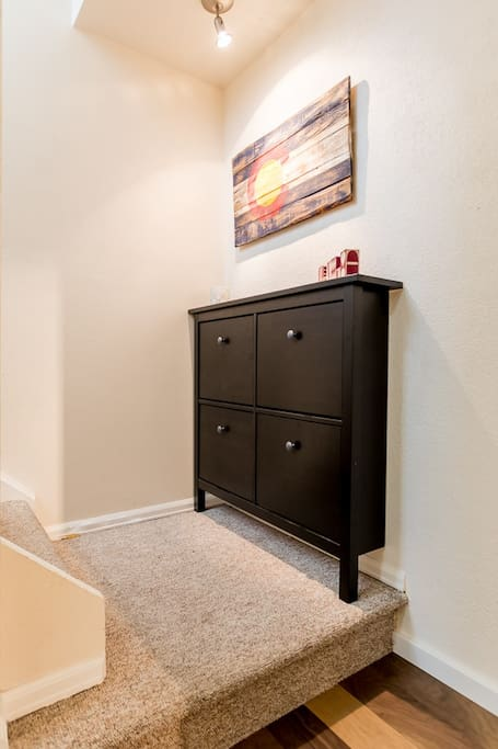 Entryway landing with shoe bin