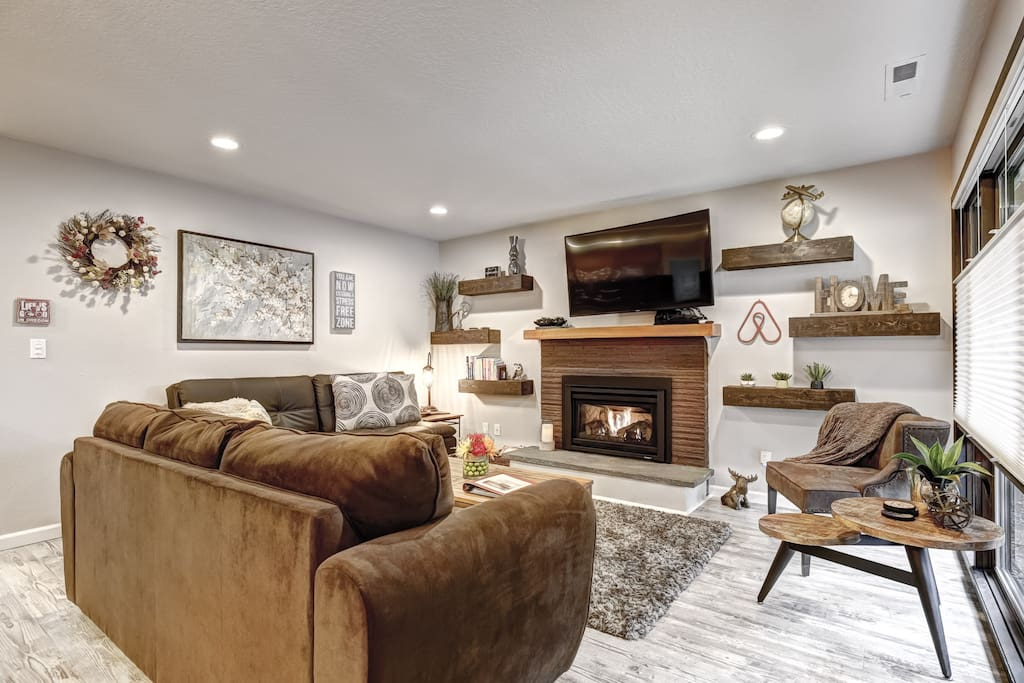 Roomy living area with a gas fireplace boasts a cozy hometown feel. Games  to occupy the children and plenty of TV apps!