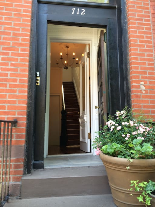 Walking up the stoop and into the apartment. You have your own entrance. Secure two front doors and very safe neighborhood.