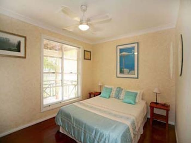 One of two sunny queen size guest bedrooms.