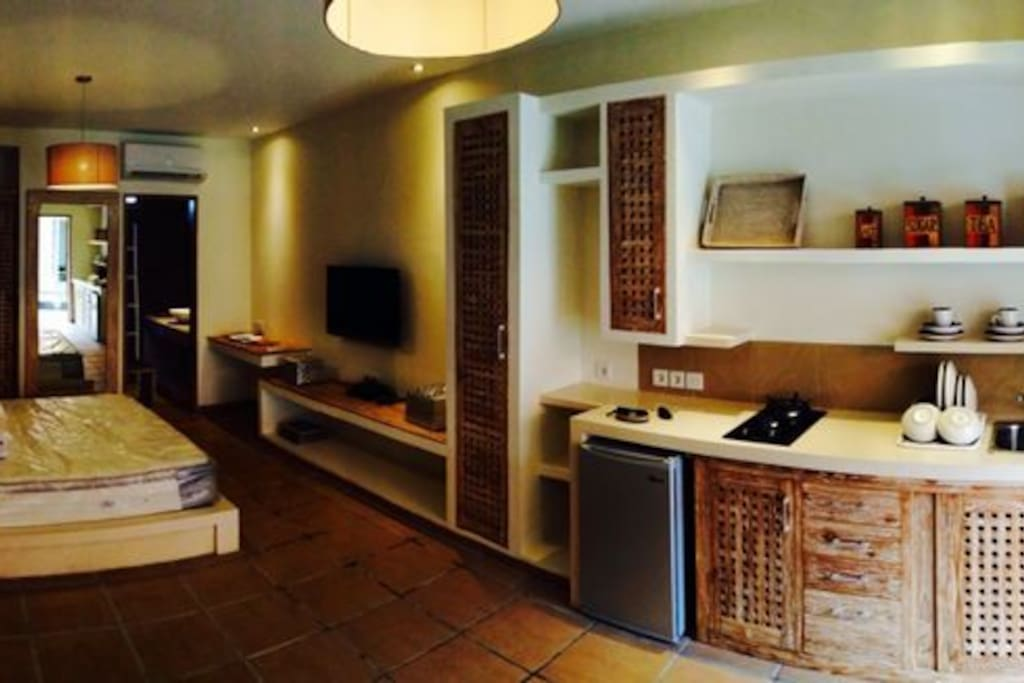 Fully furnished; kitchen, plates, pots, cups etc provided, 42 inch satellite TV; hot water; safety box; Air Con; teakwood finishings. Modern asian style