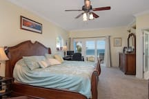 Master bedroom with king bed & wrap-around balcony overlooking beach