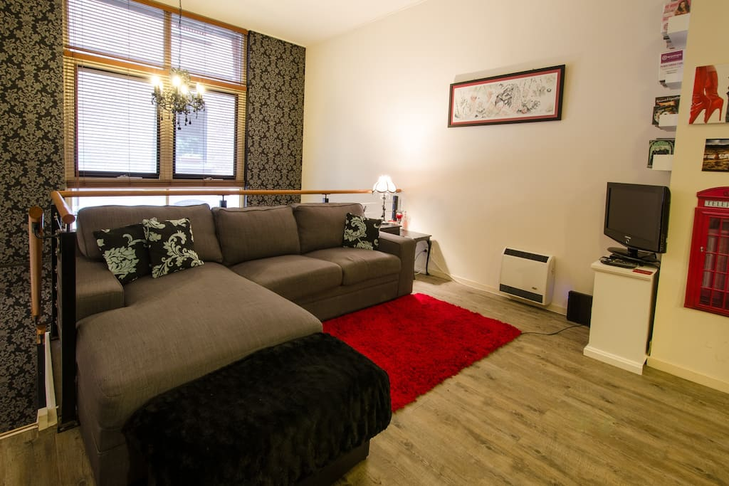"""The listing was exactly as described and just how we imagined, we definitely felt pleased as punch with our swanky pad for the weekend!""- Jo - Lounge room with sofa bed, TV, Netflix and laneway view"