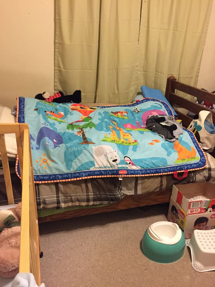 This used to one of my sons room. My grandson sleeps in the grib to the left sometimes.The  bed has  a play mat on it right now that keeps the cat off of the things that I have under neath. It can all be moved off and clean sheets and comforter can be put on the bed