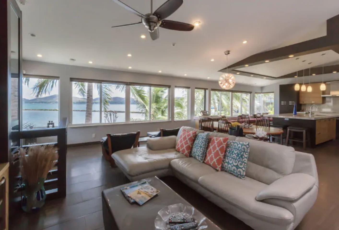 Sea Breeze Villa right on the water and views of Kaneohe Bay. Living room has recessed lighting, ceiling fans and wall to wall windows to take in the views of Kaneohe Bay.