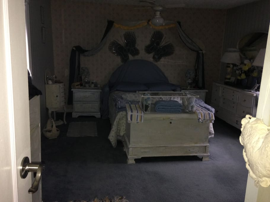 """Master Bedroom with double bed (lots of floor space for a large 12"""" thick air mattress on the floor for 2 more guests if needed)"""