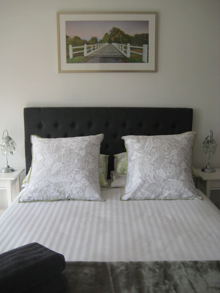 A beautiful linen bedhead and 1200 thread count linen create a lovely feel.