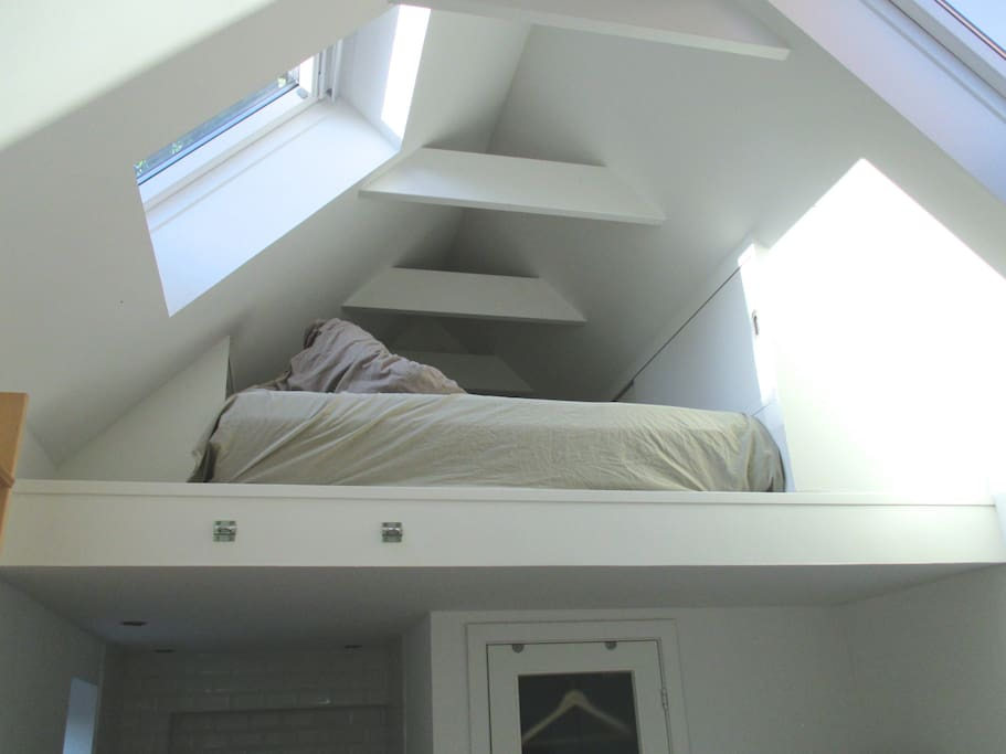 Loft with bed and storage space