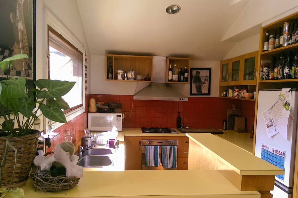 Kitchen opens onto living/dining space