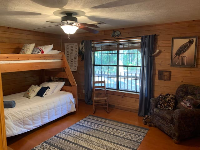 The Wildlife Room is the larger of the two downstairs bedrooms (bunk beds with a twin on top and double on bottom)