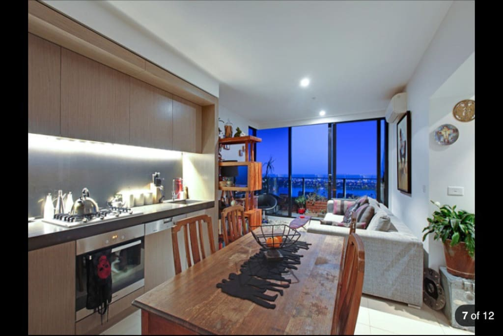 Kitchen, dinning area and lounge.   All with a magnificent view of Albert Park and the Bay Area.