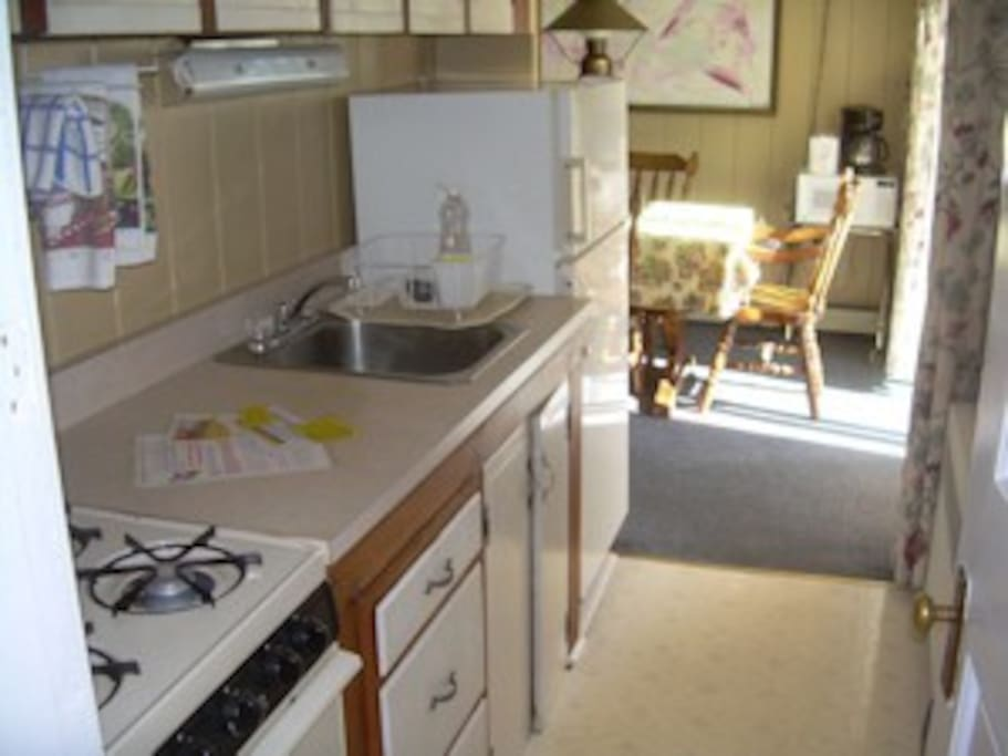 Galley style kitchen.  Sorry, no dishwasher.
